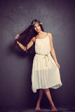Young barefoot woman in white dress Stock Photo
