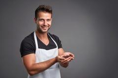 A young barista man Stock Image