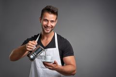 A young barista man stock photo