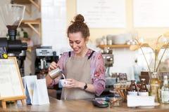 Female barista making coffee stock photos