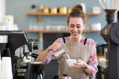 Female barista making coffee royalty free stock photo