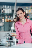 Young barista serving cookies Stock Images