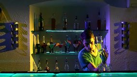 Young barman making tricks with two glasses and stock video