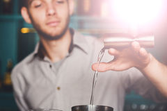 Young Barmans making shot cocktail, pouring alcohol into glass Royalty Free Stock Images