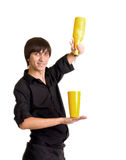 Young bartender with alcohol cocktail Royalty Free Stock Images