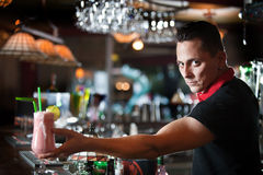 Young bartender with cocktail Stock Images