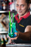 Young bartender with cocttail Stock Image