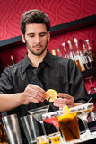 Young bartender make cocktail prepare drinks Royalty Free Stock Photography