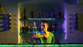 Young bartender making professional tricks with stock footage