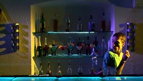 Young bartender making tricks with two glasses and stock video footage