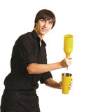 Young bartender with a shaker and bottle. On white background royalty free stock image