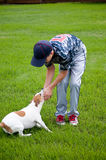 Young baseball boy and his dog Royalty Free Stock Photo