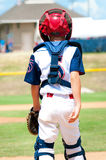 Young baseball catcher during game. Stock Photo