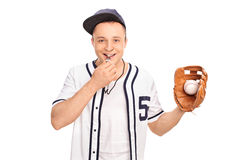 Young baseball coach blowing a whistle Stock Image