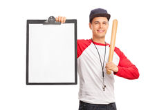 Young baseball coach holding a clipboard Royalty Free Stock Photos