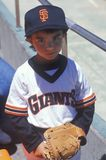 Young baseball fan with Giants jersey posing at Candlestick Park, San Francisco, CA Royalty Free Stock Photo