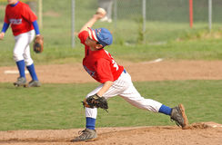 Young Baseball Pitcher. Boy pitching in baseball game stock image
