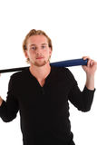 Young baseball player. Baseball as a hobbie. Young blonde man in his 20s wearing a white shirt ready to hit. White background Stock Image