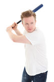 Young baseball player. Baseball as a hobbie. Young blonde man in his 20s wearing a white shirt ready to hit. White background Royalty Free Stock Photography
