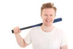 Young baseball player. Baseball as a hobbie. Young blonde man in his 20s wearing a white shirt ready to hit. White background Royalty Free Stock Photo