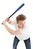 Young baseball player. Baseball as a hobbie. Young blonde man in his 20s wearing a white shirt ready to hit. White background Stock Photo