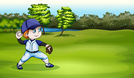 A young baseball player at the field near the river Stock Photo