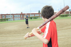 Young baseball player in a field Stock Images