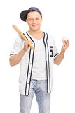 Young baseball player holding a bat Stock Photo