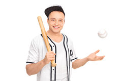 Young baseball player posing with a bat Stock Photography