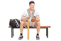 Young baseball player sitting on bench Stock Photography
