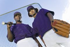 Young Baseball Players Standing Against Sky Stock Images
