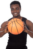 Young with basketball ball Royalty Free Stock Photo