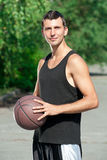 Young basketball player with ball Stock Photography