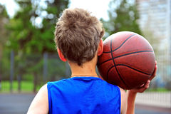 Young basketball player with a ball Royalty Free Stock Images