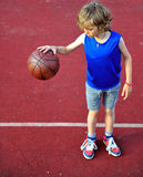 Young basketball player with a ball Royalty Free Stock Image