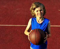 Young basketball player on the court Stock Images