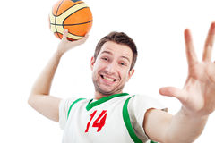 Young basketball player is dunking. Close up of young basketball player who is dunking. Isolated on white Stock Image