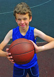 Young basketball player holding the ball Royalty Free Stock Photos