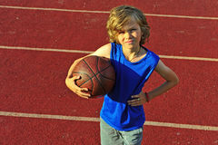 Young basketball player holding the ball Stock Photos