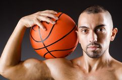 Young basketball player isolated on the white Royalty Free Stock Image
