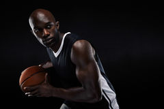 Young basketball player looking away Royalty Free Stock Photography