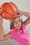 Young basketball player makes a throw Stock Photos