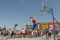 A young basketball player performs a throw to the slam dunk cont