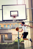 Young basketball player playing with energy. Athletic  basketball player playing with energy Royalty Free Stock Photography