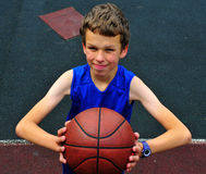Young basketball player preparing for a shot Royalty Free Stock Images