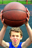 Young basketball player preparing to throw ball Royalty Free Stock Photos