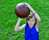 Young basketball player ready to make a shot Stock Images
