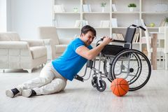 The young basketball player on wheelchair recovering from injury Royalty Free Stock Photo