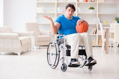 The young basketball player on wheelchair recovering from injury Stock Photo