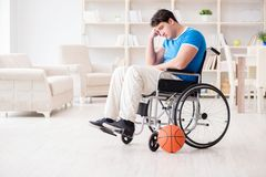 The young basketball player on wheelchair recovering from injury Stock Photos